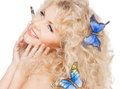 Happy woman with butterflies in hair Royalty Free Stock Photo