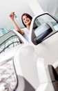 Happy woman buying a car Royalty Free Stock Photography
