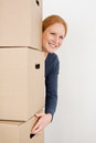 Happy woman carrying moving boxes closeup image of a cheerful young lifting up brown Stock Photo