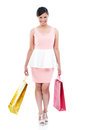 Happy woman carrying shopping bags full length portrait of a young asian over white background Stock Photo