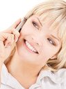 Happy woman with cell phone picture of Royalty Free Stock Photo