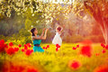 Happy woman and child in the blooming spring garden.Mothers day Royalty Free Stock Photo