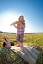 Happy woman and child in wheat field Royalty Free Stock Photo