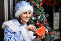 Happy woman with Christmas costume receives gift Royalty Free Stock Image