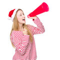 Happy woman with christmas hat and yell with megaphone Royalty Free Stock Photo
