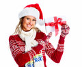 Happy woman with christmas present isolated over white background Stock Photography