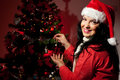 Happy woman with Christmas tree Stock Photography