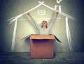 Happy woman coming out of box into a new house Royalty Free Stock Photo