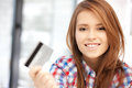 Happy woman with credit card bright picture of Stock Photography