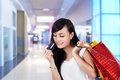 Happy woman with credit card and shopping bags Stock Photos