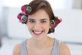 Happy woman with curlers on her head portrait of a Stock Image