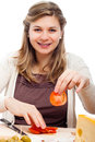 Happy woman cutting tomatoes Stock Images