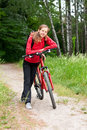 Happy woman cyclist on a bicycle walk Royalty Free Stock Photography