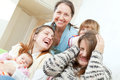Happy woman with daughters and granddaughters Stock Photo