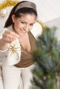 Happy woman decorating christmas tree smiling high angle view selective focus Royalty Free Stock Photo