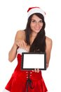 Happy woman with digital tablet wearing santa costume showing over white background Royalty Free Stock Photo