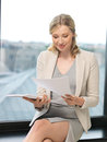 Happy woman with documents indoor picture of Stock Photo