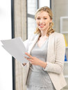 Happy woman with documents indoor picture of Stock Photos