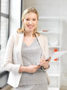 Happy woman with documents indoor picture of Stock Photography