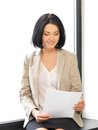 Happy woman with documents indoor picture of Stock Images