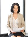 Happy woman with documents indoor picture of Royalty Free Stock Photo
