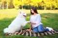 Happy woman and dog resting in the park Royalty Free Stock Photo