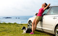 Happy woman and dog travel enjoying peace on summer beautiful girl her pet on road trip to coast copy space Stock Image