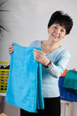 Happy woman doing housework a smiling middle agged Stock Photography