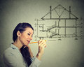 Happy woman drawing new house plan with pencil Royalty Free Stock Photo