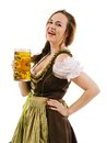 Happy woman drinking beer during oktoberfest photo of a beautiful wearing traditional dirndl laughing and holding a huge Royalty Free Stock Photos