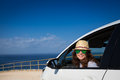 Happy woman driver at the beach summer vacations concept Stock Photography