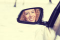 Happy woman driver reflection in car side view mirror. Safe winter trip, journey driving concept Royalty Free Stock Photo