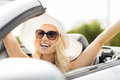Happy woman driving in cabriolet car Royalty Free Stock Photo