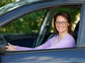 Happy woman driving car in country Royalty Free Stock Image