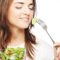 Happy woman eating salad portrait of young Stock Images