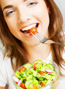 Happy woman eating salad portrait of young Royalty Free Stock Photography
