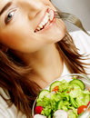 Happy woman eating salad portrait of young Royalty Free Stock Photos