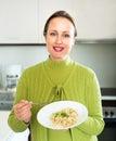 Happy woman eats rice Royalty Free Stock Photo