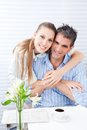 Happy woman embracing her husband women at breakfast Royalty Free Stock Photo