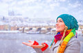 Happy woman enjoy snowfall portrait of cute in beautiful prague city catches snowflakes by hands with pleasure enjoying winter Stock Photography