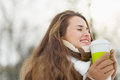 Happy woman enjoying hot beverage in winter park Stock Photography