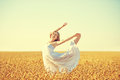 Happy woman enjoying life in golden wheat field Royalty Free Stock Photo