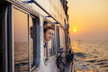 Happy woman enjoying the sea from ferry boat on sunset Royalty Free Stock Photo