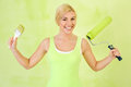 Happy woman with equipment for painting end of Royalty Free Stock Photos