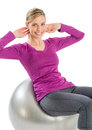 Happy woman exercising on fitness ball portrait of young isolated over white background Stock Images