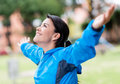 Happy woman exercising outdoors very with arms open Royalty Free Stock Image