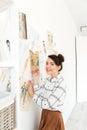 Happy woman fashion illustrator drawing