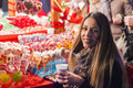 Happy woman Feeling the urban christmas vibe at night. Happy woman looking up with christmas light at night. Royalty Free Stock Photo