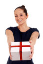 Happy woman with gift box over white background Stock Photos
