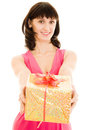 Happy woman with gift in red dress Royalty Free Stock Image
